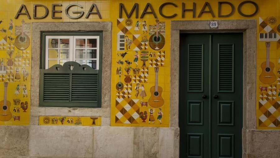 The beautiful façade of the Adega Machado is covered in painted tiles
